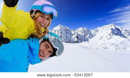 Ski - portrait of young skiers, couple having fun on ski