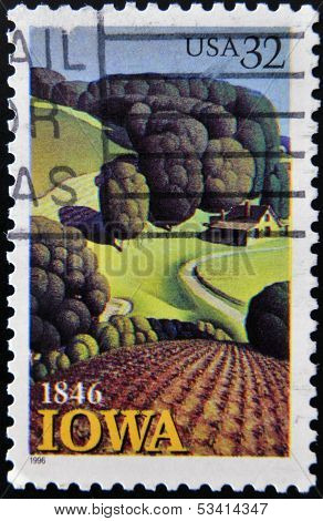 A Stamp printed in USA shows the Young Corn by Grant Wood Iowa Statehood