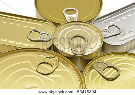 Detail of various cans of silver and gold preserves