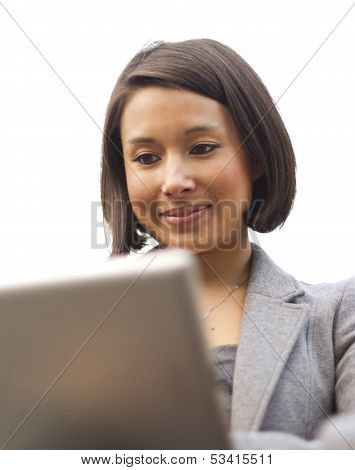 Attractive woman using a wireless tablet