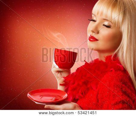 Beautiful Blonde Woman Drinking Coffee