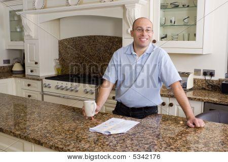 Happy Man In Modern Kitchen