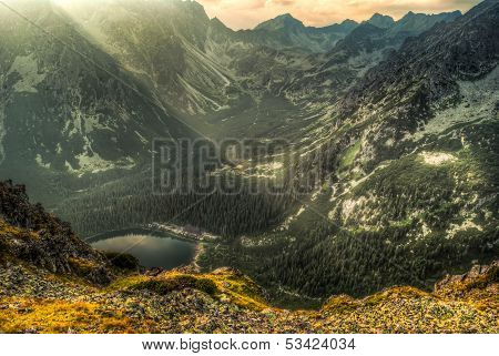 Mountain Landscape With Pond And Mountain Chalet