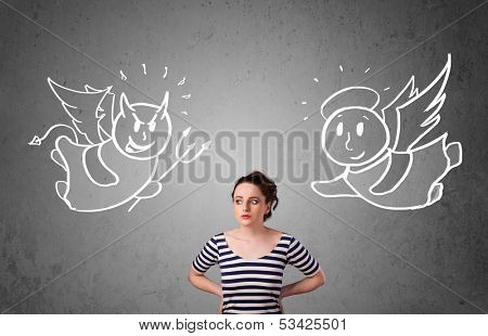 Young woman standing between the angel and the devil drawings