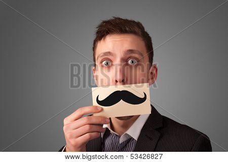 Happy businessman holding funny mustache card on his mouth with gradient background