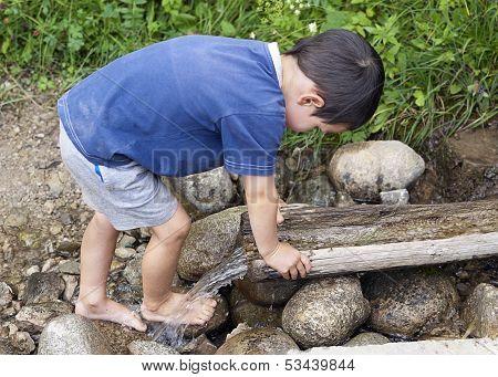 Child At  Water Stream