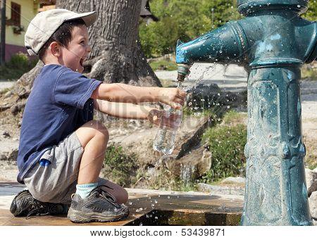 Child Filling Water Bottle