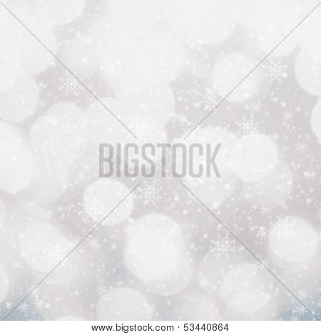 Defocused Silver And White Christmas Bokeh Background With Snowflakes. Festive  Blur  Christmas Back