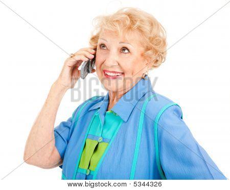 Alegre mulher sênior no celular