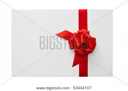 a blank card with a red ribbon bow with a copy-space on a white background