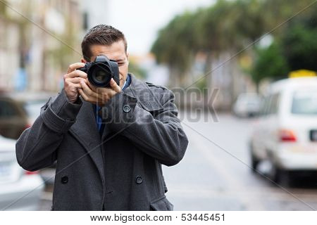 professional journalist taking photos outdoors