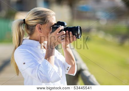 amateur middle aged photographer taking pictures outdoors