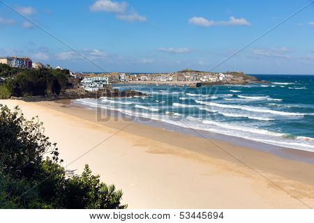 Porthminster beach St Ives Cornwall England UK with white waves and blue sea and sky