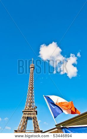 Eiffel tower with france flag in Paris