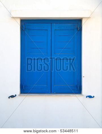 blue painted wooden window shutters