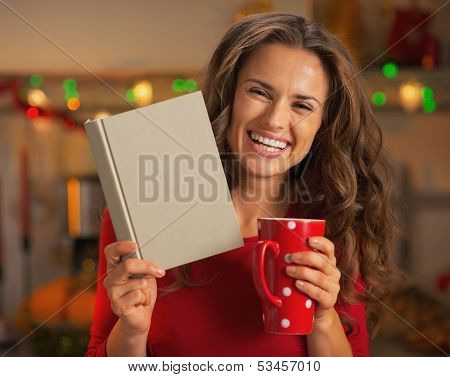 Happy Young Woman With Cup Of Hot Chocolate Reading Book In Chri