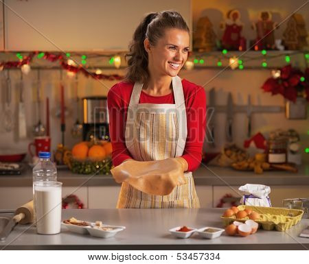 Happy Young Housewife Making Dough For Christmas Cookies