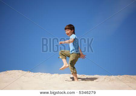 Boy Marching On Beach