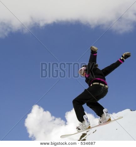 Snowboarder Girl Jumping Over The Snow