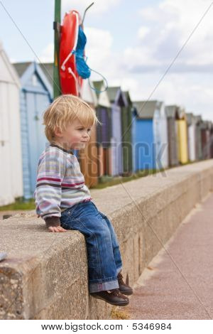 Boy By Beach Huts
