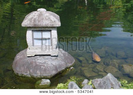Stone Lantern And Fish