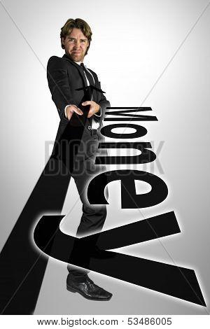 Businessman Pulling Money Towards Himself