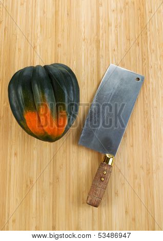 Autumn Acorn Squash With Butcher Knife On Cutting Board
