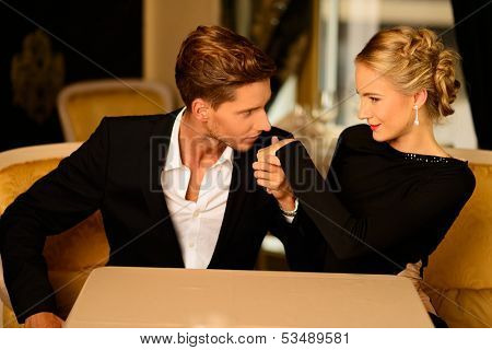 Well-dressed couple in luxury interior