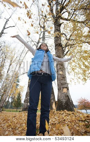 Leaves Falling On Girl.