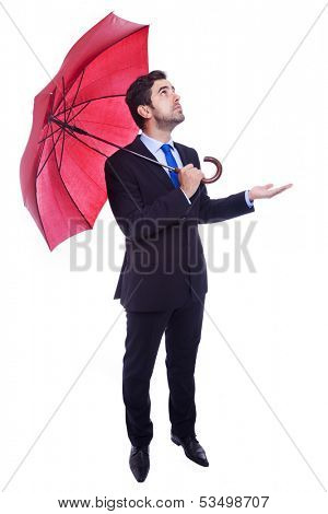 Handsome businessman with opened umbrella checking if its raining, isolated on a white background