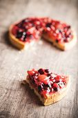 delicious fruit tart dessert on wooden background