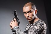 picture of trooper  - Soldier with guns against dark background - JPG