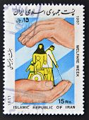 ISLAMIC REPUBLIC OF IRAN - CIRCA 1987: Stamp printed in Iran dedicated to welfare week circa 1987