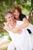 foto of mature adult  - beautiful mature couple in love having fun outdoors - JPG
