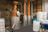 stock photo of copper  - Seattle area microbrewery distillery copper still pot - JPG