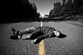 stock photo of accident victim  - Empty Road With Dead Body in the Middle At Night - JPG