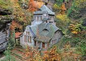 stock photo of house woods  - Fairytale house in the middle of a small Czech town of Hrensko - JPG