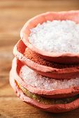 foto of crystal salt  - different type of salt in rustic clay bowls   stacked - JPG