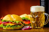 stock photo of hamburger  - still life with traditional homemade hamburger and beer - JPG