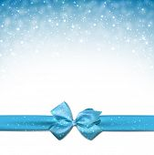 foto of ice crystal  - Winter blue background with crystallic snowflakes with ribbon and gift bow - JPG