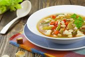 stock photo of vegetable soup  - Minestrone italian vegetable soup with pasta in the plate