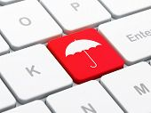 Privacy concept: Umbrella on computer keyboard background