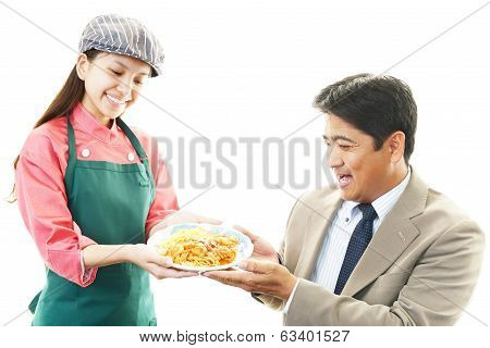 smiling waitress&customer have a meal