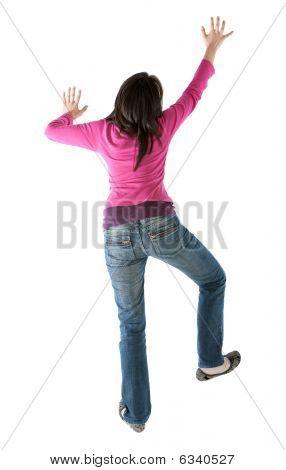 Woman Climbing A Wall