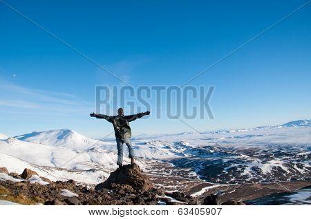 Man at Icelandic ice desert landscape