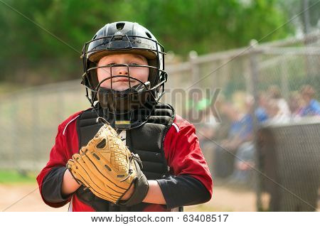 Portrait of child baseball player wearing catcher gear