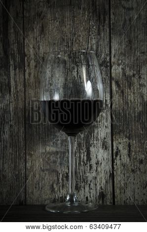 Red Wine On Old Wooden Background