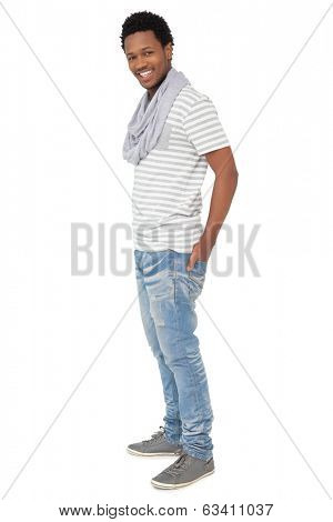 Full length portrait of a trendy young man standing over white background