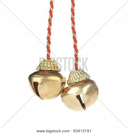 Golden jingle bells on a rope.