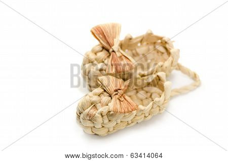 A pair of handmade braided sandals with strawy bow-knot
